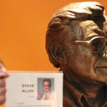 Statue of Steve Allen and post of Steve allen's accomplishments in television. The sttue is housed in the Los Angeles Press Club Steve Allen's Theatre.